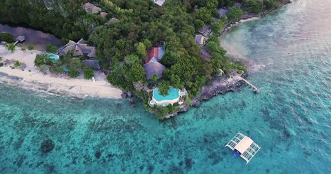 Aerial view or Top view of bay and shore in Sumilon island,oslob, Cebu, Philippine. It is a best place to snorkel and scuba drive. There is a deep clean blue ocean and nice cozy hotel.