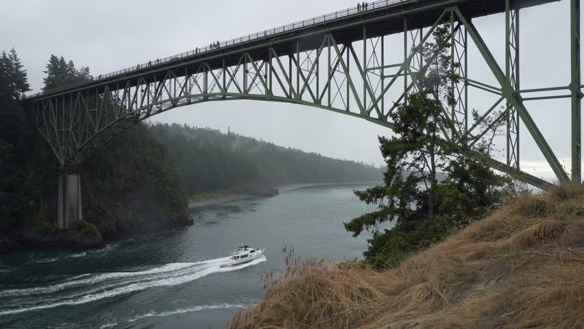 Ultra high definition 4k movie of Deception Pass bridge over the strait separating Whidbey Island from Fidalgo Island in Washington. The strait connects Skagit Bay, part of Puget Sound, with the Strai