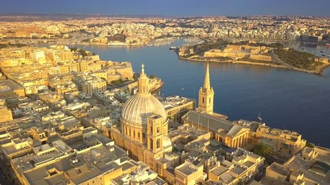 Valletta, Malta - 4K flying around Mount Carmel Basilica and St.Paul's Cathedral at surise
