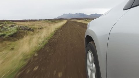 A steady gimbal footage out of aing car. On a dirt road in Iceland.