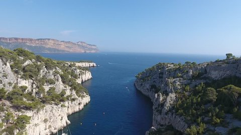 Amazing view getting out a creek (calanque d'en vau) in south of france. Drone shot, sunny day, cassis in background.