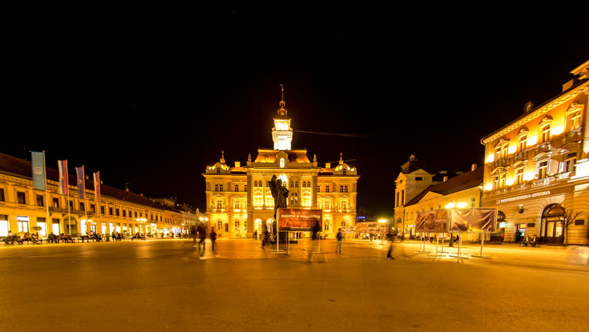 NOVI SAD, SERBIA - MAY 22: Time-lapse view on the center of the city at night as People pass by on May 22, 2017 in Novi Sad, Serbia.