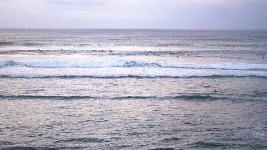 Uluwatu. Surfers surfing in ocean. Number four surf destination in the world for surfers of all abilities. slow motion, Bali, Indonesia. 3840x2160   Shutterstock HD Video #1013468906