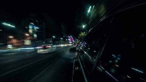 Point of view hyperlapse of a car driving on a city street at night