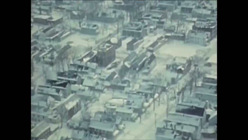 CIRCA 1977 - US military grade snow removal equipment is required to dig Buffalo out of a massive snowstorm (narrated in 1979).