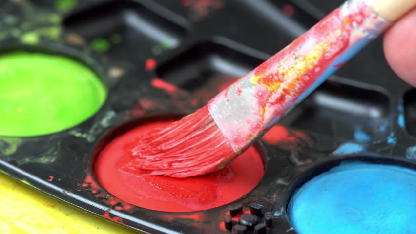 Brush taking red watercolor on color palette  | Shutterstock HD Video #1013598416