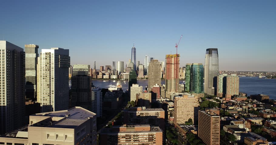 Aerial drone footage of the neighborhoods, highways and skyscrapers surrounding Jersey City, New Jersey. The footage was shot in the summer of June 2018. | Shutterstock HD Video #1013611406