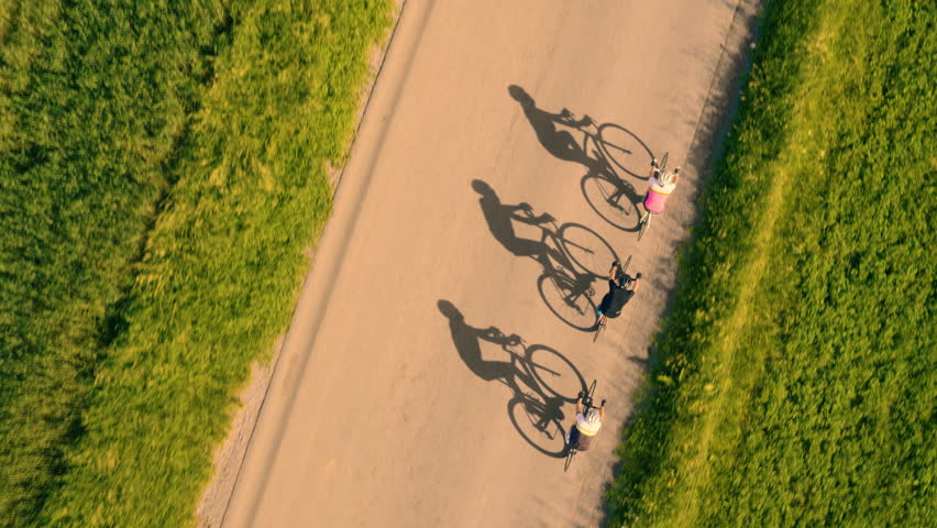 Aerial view of road cyclists shadows on the road