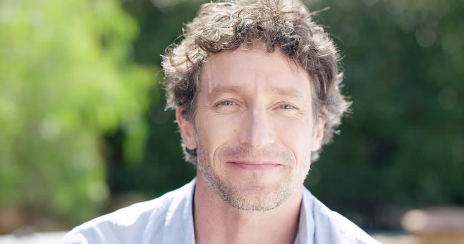 Close up of Attractive Mature man smiling portrait slow motion RED DRAGON | Shutterstock HD Video #10136456