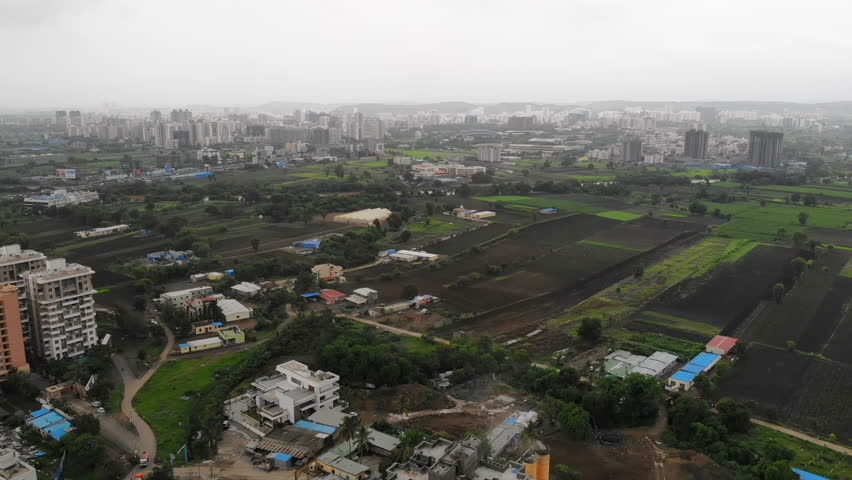 Aerial panoramic view of cityscape of modern industrial city of Pune during monsoon season - Maharashtra, landscape panorama of India, Asia from above