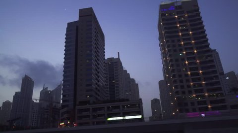 Dubai, UAE - April 08, 2018: Evening view of the skyscrapers of Dubai Marina stock footage video