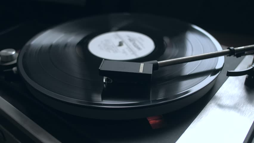 Old vintage good looking turntable playing a track with vinyl. 4k Uhd. Cinematic footage.