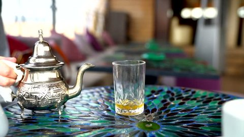 Enjoying the local custom of mint tea at a cafe in the Medina section of Marrakech, Morocco.