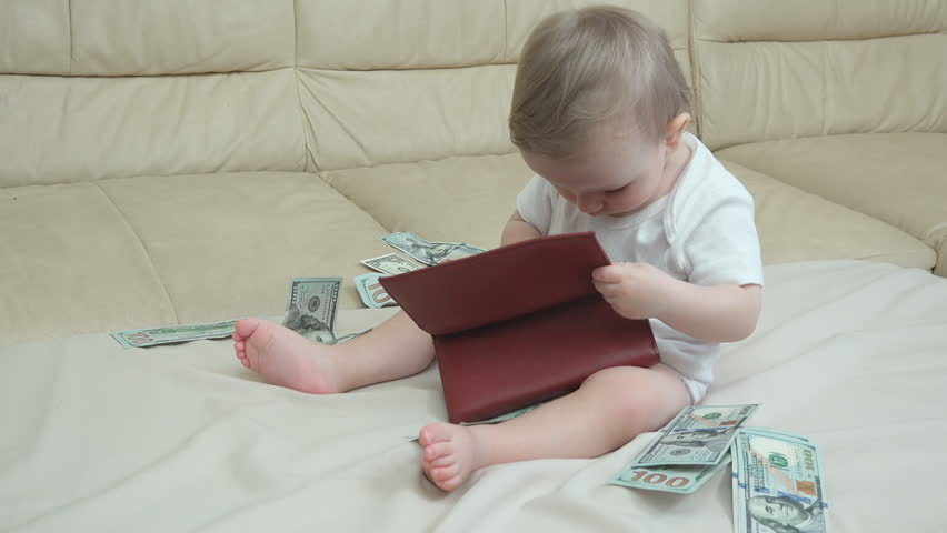 Cute baby playing with the money from the wallet   Shutterstock HD Video #1013777876