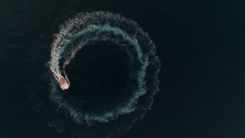Aerial yacht boat spinning and making circle waves at sea in Monaco, Monte Carlo