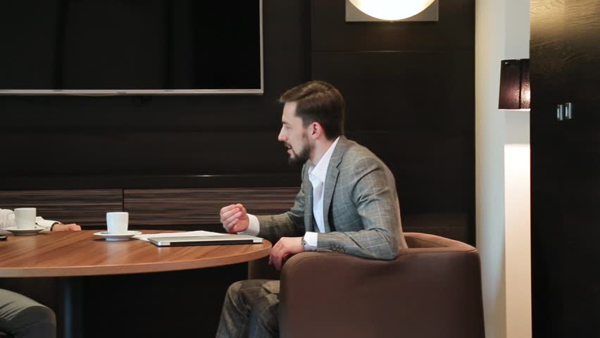 Two men at a business meeting   Shutterstock HD Video #1013808446