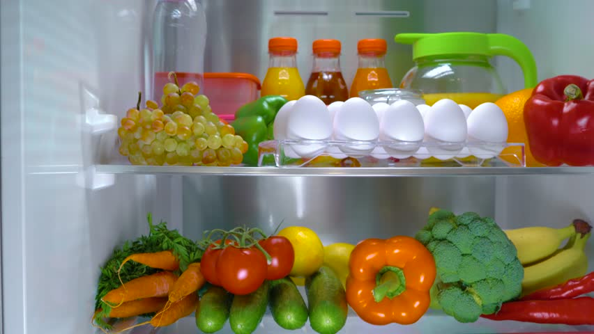 Open refrigerator filled with food. Healthy food.   Shutterstock HD Video #1013810756
