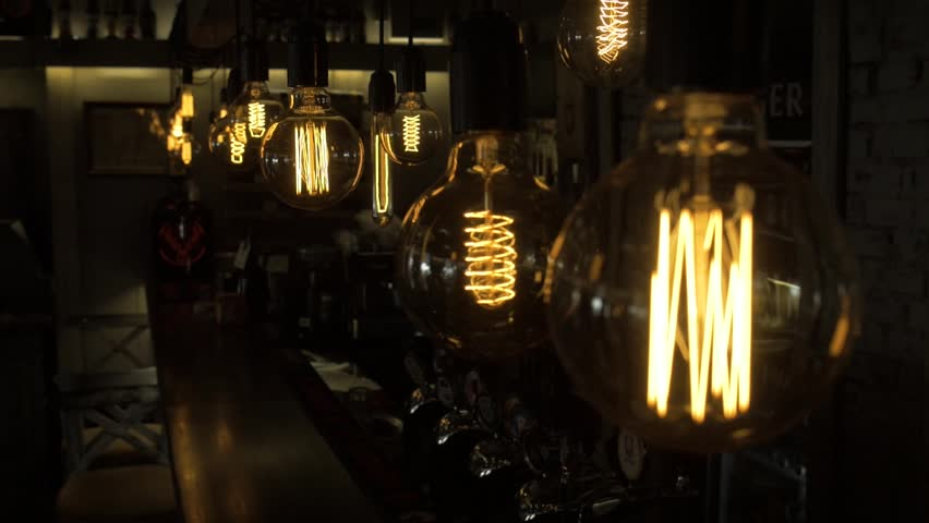 Close up of a lamp in a cafe. The staff behind the bar in the background. slow motion | Shutterstock HD Video #1013813366
