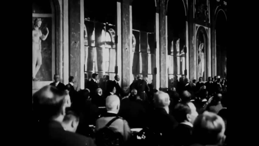CIRCA 1919 - Crowds watch as British and American delegates sign the Treaty of Versailles.