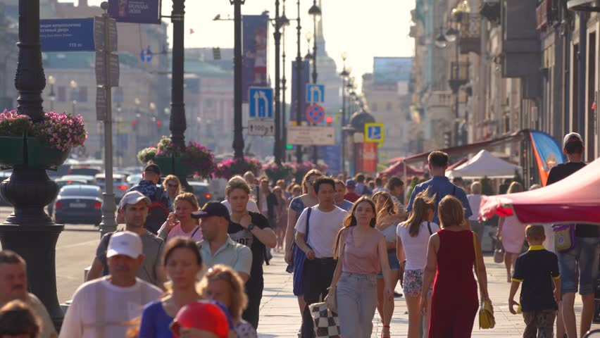 Saint-Petersburg, RUSSIA - July 17 2018, 4k, Pedestrians moving along Nevsky Prospect (Nevsky Avenue), on July  17, 2018 in Saint-Petersburg, Russia #1013824136