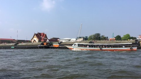 pov view at the Chao Phraya river from a tour motor boat in Bangkok