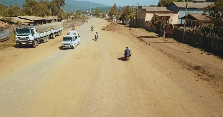 Aerial of rural African street traffic