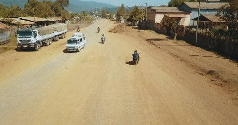 Aerial of rural African street traffic