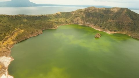 Aerial view Lake crater at Taal Volcano on Luzon Island North of Manila in Philippines. Volcano with a crater on an island in the middle of a lake. Luzon, Philippines. 4K video. Travel concept. Aerial