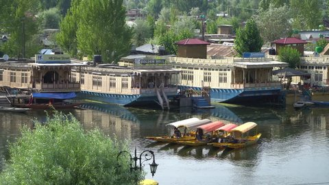 Houseboats on the lake Dal and boats floating along it. Srinagar, India, 02.07.2018