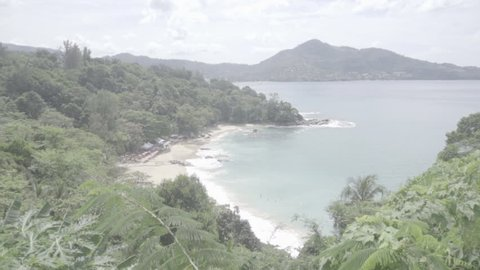 Scenic view from above on a snow-white sandy beach and tropical island. The azure quiet sea washes the islands. S-log, ungraded