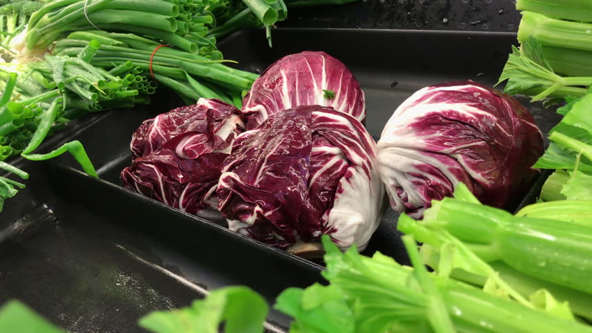 Motion of woman buying radicchio inside supermarket with 4k resolution | Shutterstock HD Video #1013892896