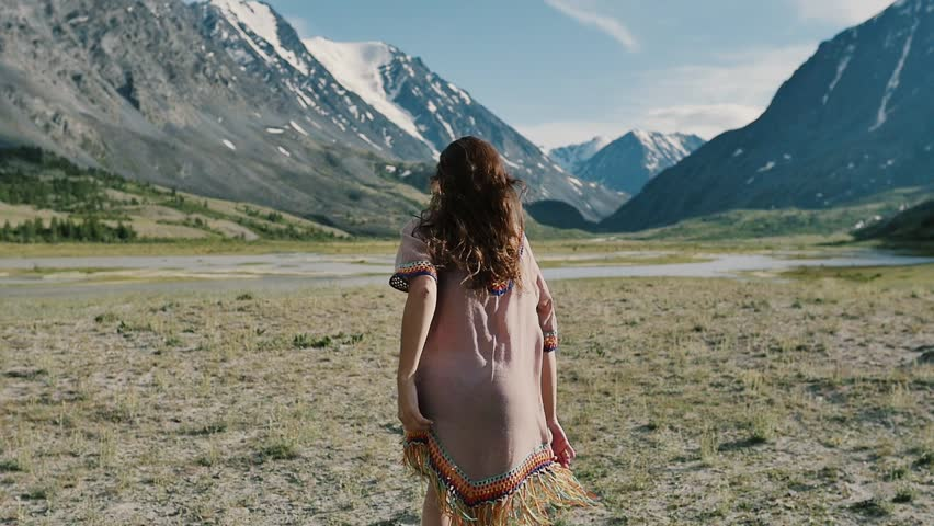 Woman on top of mountain. Girl lifting arm up celebrating scenic nature landscape enjoying vacation travel adventure   Shutterstock HD Video #1013896376