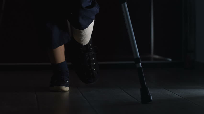 Walking with crutches at night. injury, accident,difficulty | Shutterstock HD Video #1013917226