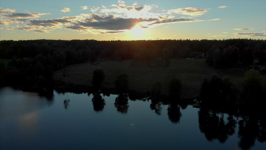 Ascending drone footage of a beautiful sunset | Shutterstock HD Video #1013946296