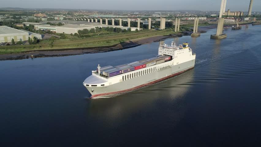 ro-ro cargo ship Adeline flies past drone on Thames. Queen Elizabeth II Bridge is in the background