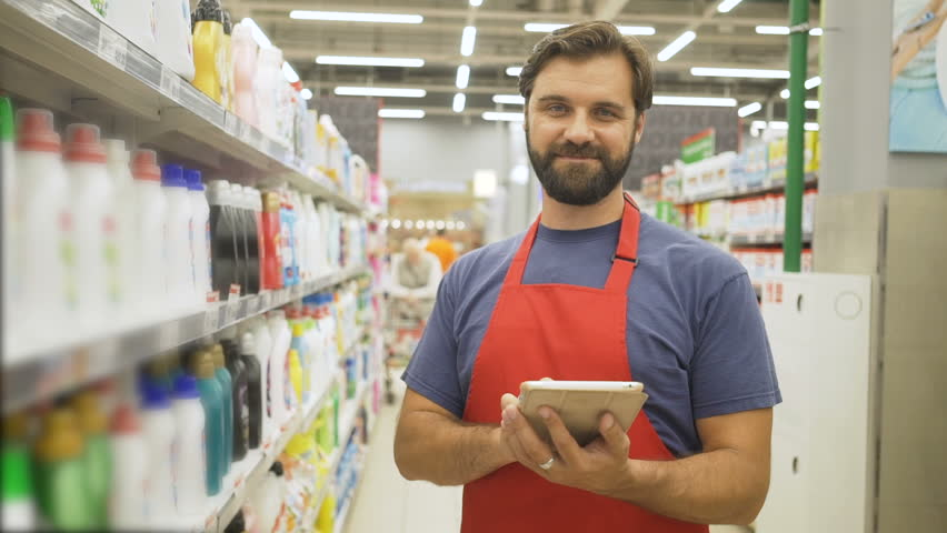 Sales clerk with digital tablet doing a stocktake in household store | Shutterstock HD Video #1013987486