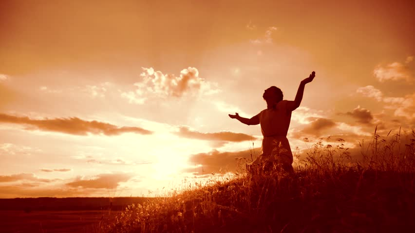 Girl folded her hands in prayer lifestyle silhouette at sunset. woman praying on her knees. slow motion video. Girl folded her hands in prayer pray to God. the girl praying asks forgiveness for sins | Shutterstock HD Video #1014074936