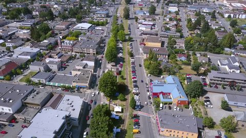 Duncan, British Columbia, Canada on Vancouver Island. Unique 4k Upwards Tilting Drone Shot of the Main Street and Downtown Area