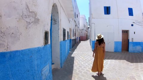 Woman walking in a street of a village in Morocco