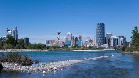 4K Time lapse of Calgary Skyline at daytime with Bow river in foreground