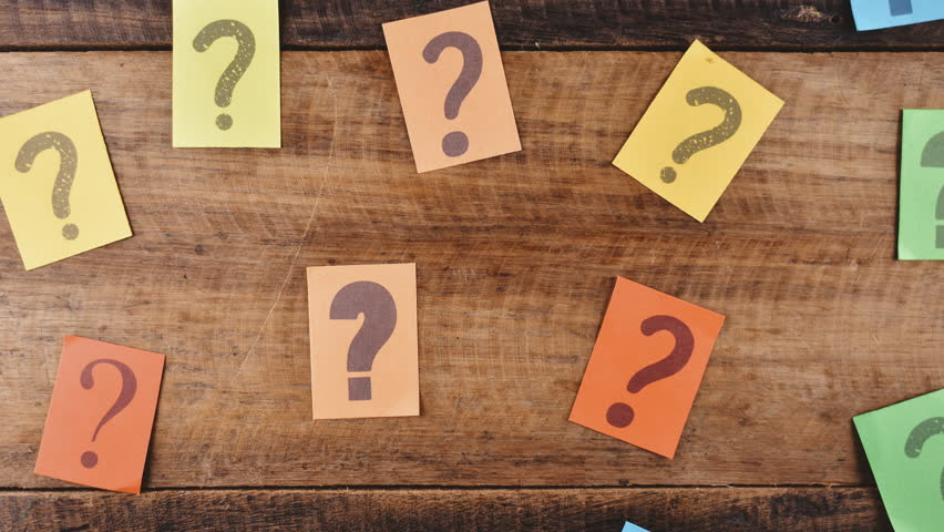 4K Stop Motion - Group of colorful paper with QUESTION MARK moving down on wooden table. Concept of FAQ, Questions, Q&A and problems | Shutterstock HD Video #1014125306
