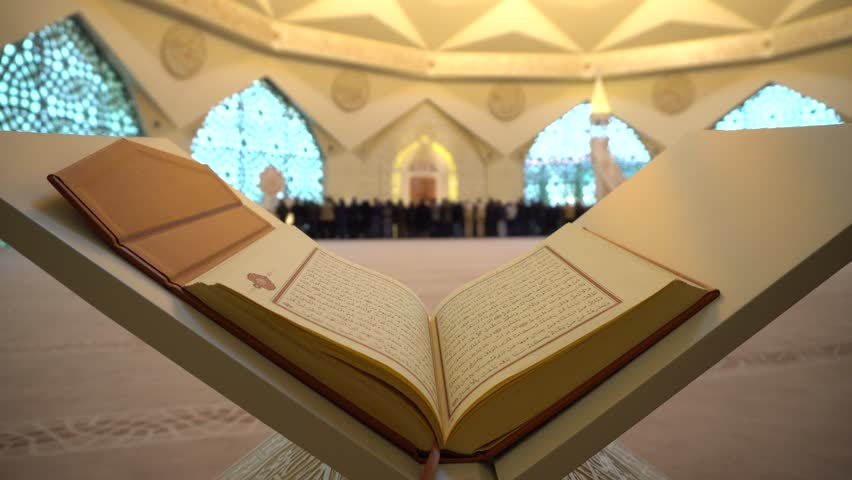 A Man Is Reading Quran Or Koran On The Reading Desk In A Mosque. | Shutterstock HD Video #1014138116