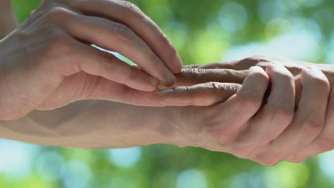 Gay wedding proposal, decision to live together, creating family, hands closeup