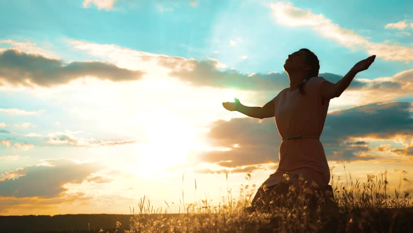 Girl folded lifestyle her hands in prayer silhouette at sunset. woman praying on her knees. slow motion video. Girl folded her hands in prayer pray to God. the girl praying asks forgiveness for sins | Shutterstock HD Video #1014141836