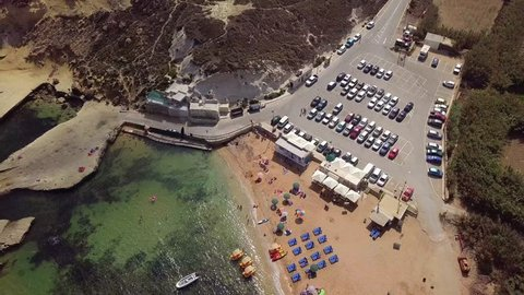 Aerial view of the rocky and sandy beaches of Gnejna Bay, Malta in Summer
