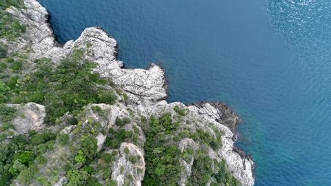 Aerial top down view rough cliffs of Amalfi Coast is popular tourist destination for  region and Italy as whole attracting thousands of tourists annually and is  listed as UNESCO World Heritage Site