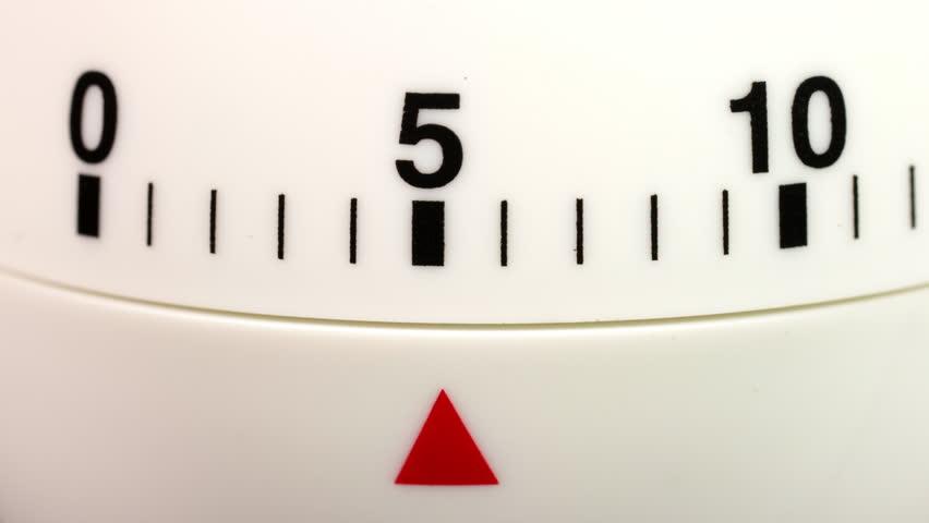 White kitchen egg timer countdown to zero time lapse. | Shutterstock HD Video #1014192776
