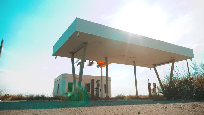 Old dirty deserted gas station. U.S. Route 66. crisis road 66 fueling slow motion video. closed supermarket store shop Abandoned gas station oil end of fuel the world lifestyle apocalypse petrol. main | Shutterstock HD Video #1014193256