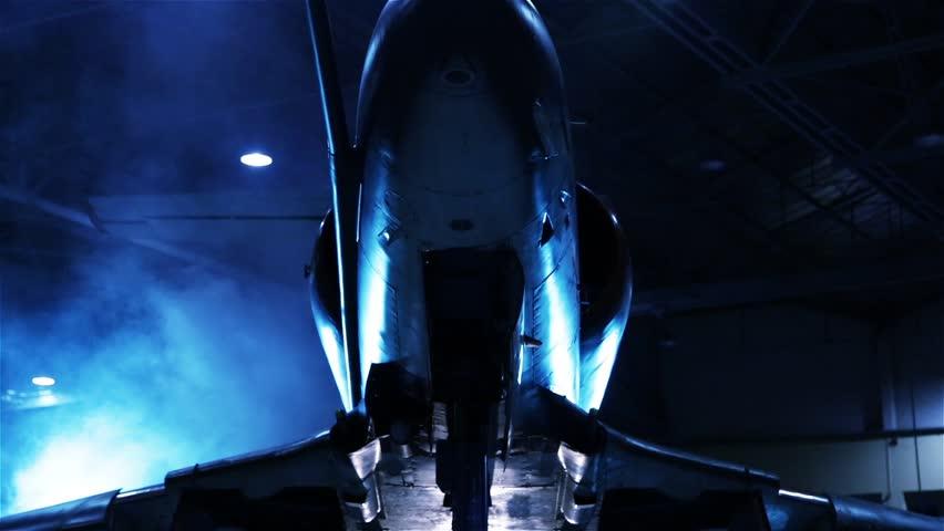 Fighter Jet in a Hangar. Blue Tone. Pan Shot.