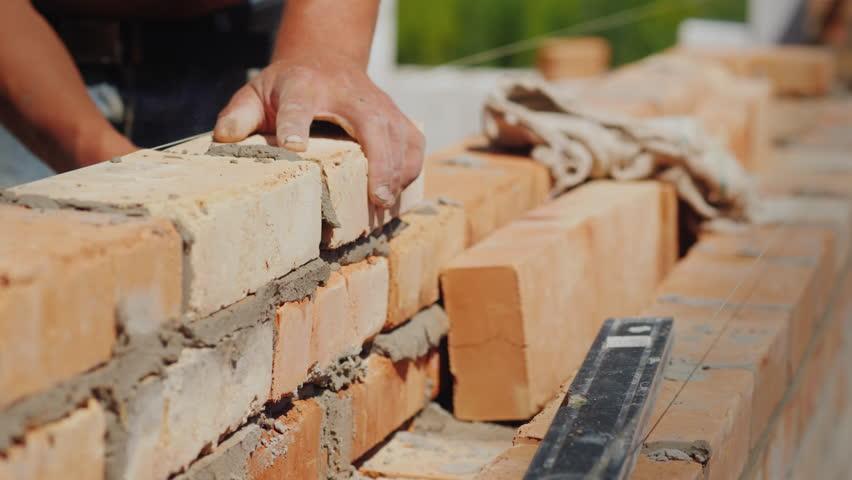 Brick masonry close-up, construction of a new house